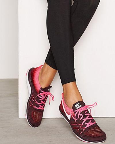 Till dam från Nike, en röd löparsko.