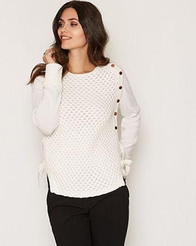 Till dam från Dagmar, en vit stickade tröja.