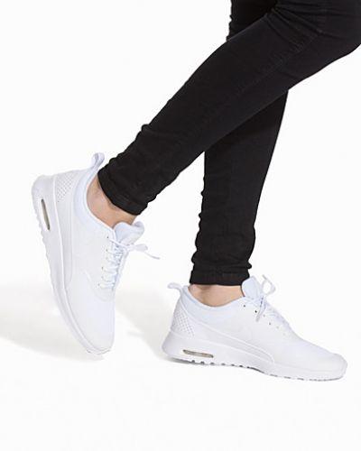 Vit sneakers från Nike till dam.