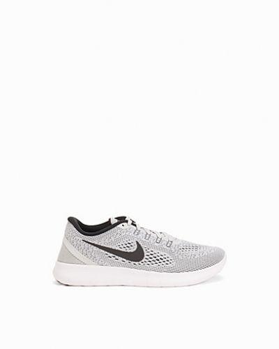 Till dam från Nike, en vit löparsko.