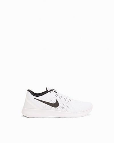Vit löparsko från Nike till dam.