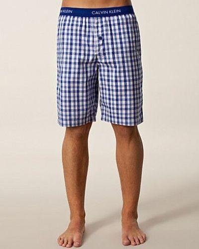 Till herr från Calvin Klein, en flerfärgad pyjamas.