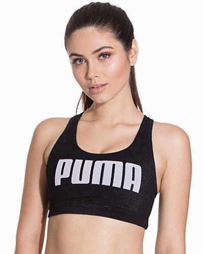 Till tjejer från Puma, en svart sport bh.