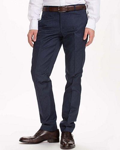 Blå kostymbyxa från Selected Homme till herr.