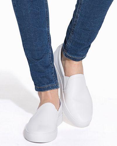 Till dam från Vagabond, en vit sneakers.
